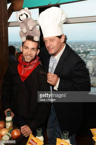 Marco Pierre White poses with a finalist at the Walkers 'Do Us A Flavour' finalists launch at Centrepoint on July 28 2014 in London England
