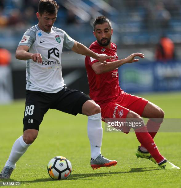 Marco Poletanovic of FC Tosno and Aleksandr Samedov of FC Spartak Moscow vie for the ball during the Russian Football League match between FC Tosno...
