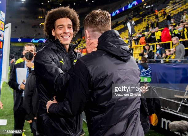 Marco Reus and Axel Witsel of Borussia Dortmund after the final whistle during the Champions League Group C match between Borussia Dortmund and...