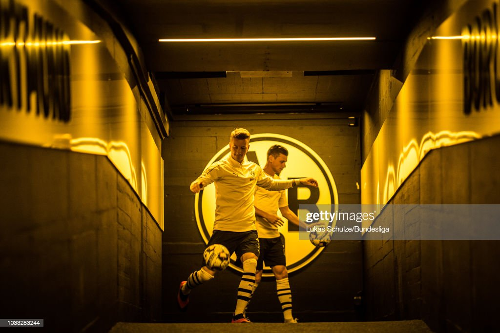 Marco Reus (L) and Lukasz Piszczek (R) of Dortmund are kicking their balls in the players tunnel for the warm up prior to the Bundesliga match between Borussia Dortmund and Eintracht Frankfurt at Signal Iduna Park on September 14, 2018 in Dortmund, Germany.