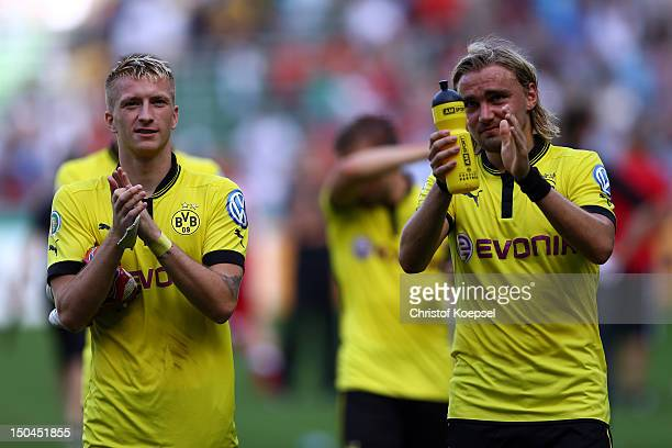 Marco Reus and Marcel Schmelzer of Dortmund celebrate the 3-0 victory after the first round DFB Cup match between FC Oberneuland and Borussia...