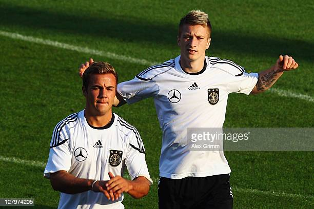 Marco Reus and Mario Goetze warm up during the Germany training session at Bruchweg Stadium on October 4 2011 in Mainz Germany