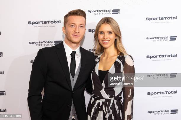 Marco Reus and Scarlett Gartmann attend the SportsTotal Christmas Party and foundation gala at Flora Koeln on December 01, 2019 in Cologne, Germany.