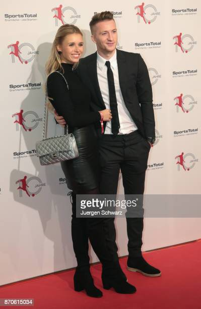 Marco Reus and Scarlett Gartmann pose at the 10th anniversary celebration of the Sports Total Agency on November 5 2017 in Cologne Germany