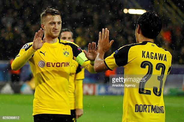 Marco Reus and Shinjii Kagawa of Borussia Dortmund celebrate after scoring a goal during the UEFA Champions League group F soccer match between...