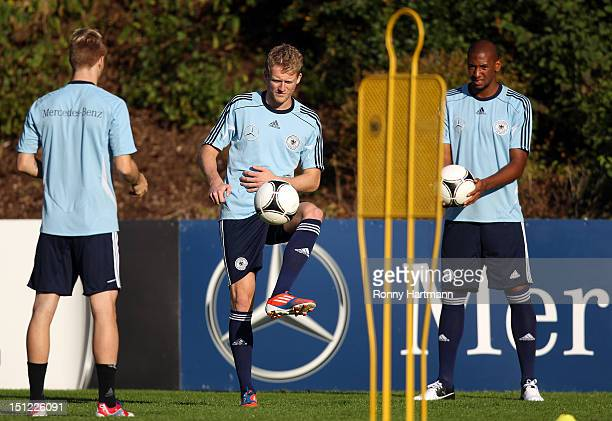 Marco Reus, Andre Schuerrle and Jerome Boateng during a training session on September 04, 2012 in Barsinghausen, Germany, three days before their...