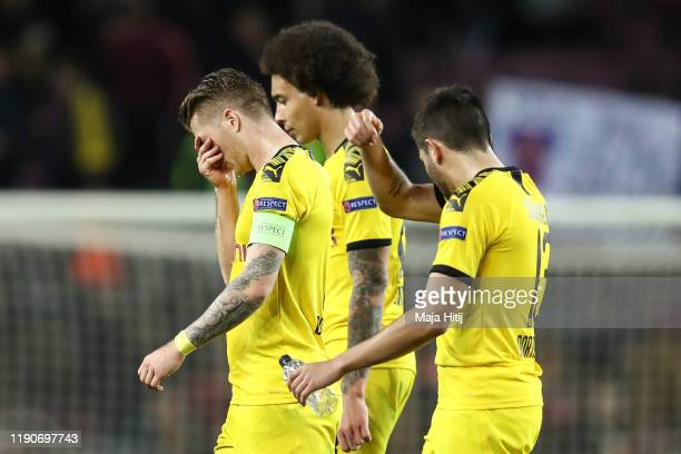 Marco Reus , Axel Witsel and Raphael Guerreiro of Borussia Dortmund reacts after the UEFA Champions League group F match between FC Barcelona and...