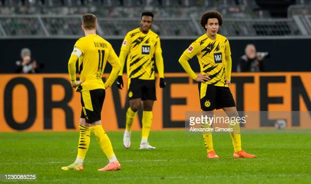 Marco Reus, Dan-Axel Zagadou and Axel Witsel of Borussia Dortmund after the final whistle during the Bundesliga match between Borussia Dortmund and...