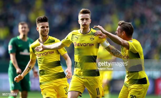 Marco Reus Dortmund celebrates after he scores the opening goal during the Bundesliga match between SV Werder Bremen and Borussia Dortmund at...