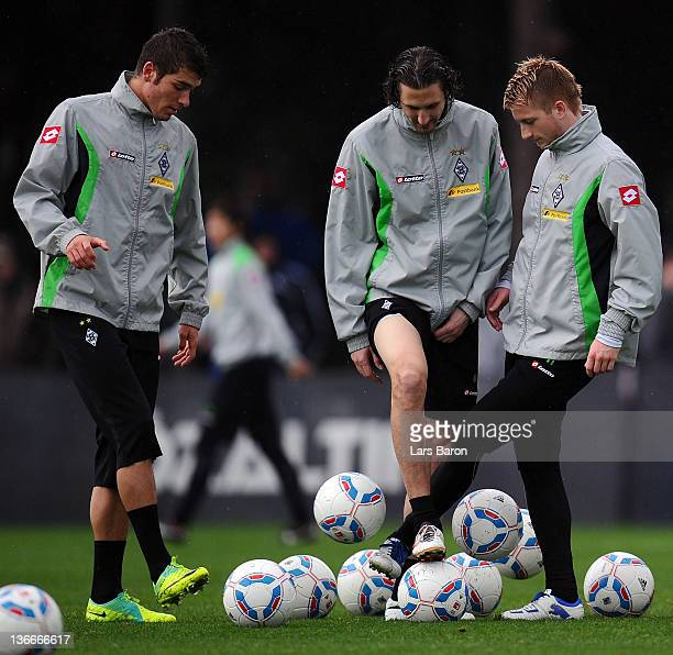 Marco Reus is seen with Roman Neustaedter and Roel Brouwers during a training session at day six of Borussia Moenchengladbach training camp on...
