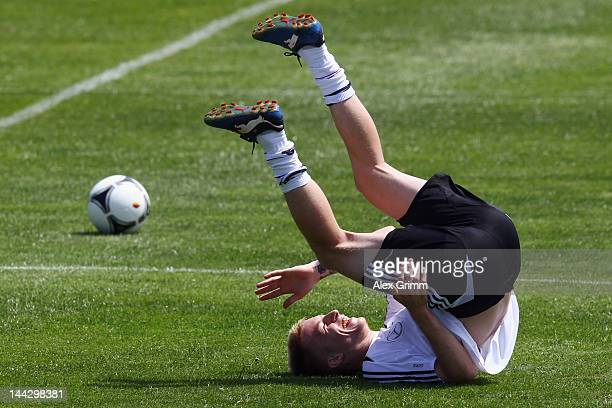 Marco Reus laughs after falling during a Germany training session at Campo Sportivo Comunale Andrea Dora on May 13 2012 in Olbia Italy