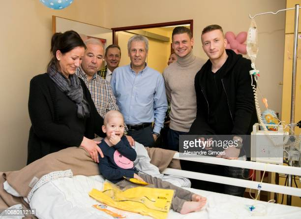 Marco Reus Lukasz Piszczek and head coach Lucien Favre of Borussia Dortmund during the annual visit at the Children's Hospital on December 03 2018 in...