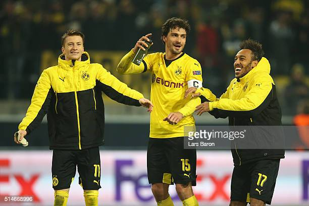Marco Reus Mats Hummels and PierreEmerick Aubameyang of Borussia Dortmund celebrate after victory in the UEFA Europa League Round of 16 first leg...