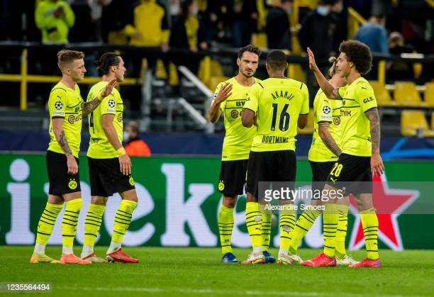 Marco Reus, Mats Hummels, Manuel Akanji and Axel Witsel of Borussia Dortmund after the final whistle during the Champions League Group C match...