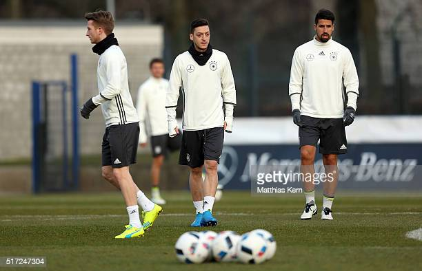 Marco Reus Mesut Oezil and Sami Khedira look on during a Germany training session ahead of the international friendly match against England at...