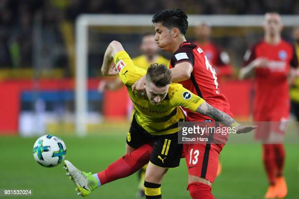Marco Reus of Borussia Dortmund and Carlos Salcedo of Eingtrackt Frankfurt compete for the ball during the Bundesliga match between Borussia Dortmund...