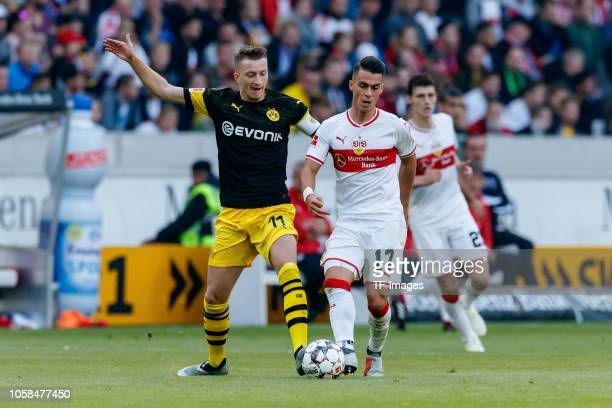 Marco Reus of Borussia Dortmund and Erik Thommy of VfB Stuttgart battle for the ball during the Bundesliga match between VfB Stuttgart and Borussia...