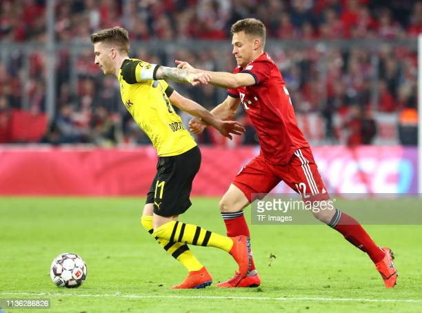 Marco Reus of Borussia Dortmund and Joshua Kimmich of FC Bayern Muenchen battle for the ball during the Bundesliga match between FC Bayern Muenchen...