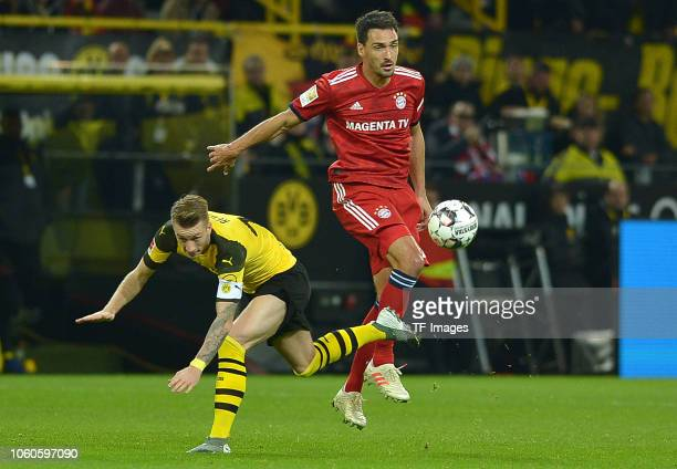 Marco Reus of Borussia Dortmund and Mats Hummels of Bayern Muenchen battle for the ball during the Bundesliga match between Borussia Dortmund and FC...