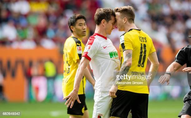 Marco Reus of Borussia Dortmund and Paul Verhaegh of FC Augsburg during the Bundesliga match between FC Augsburg and Borussia Dortmund at the...