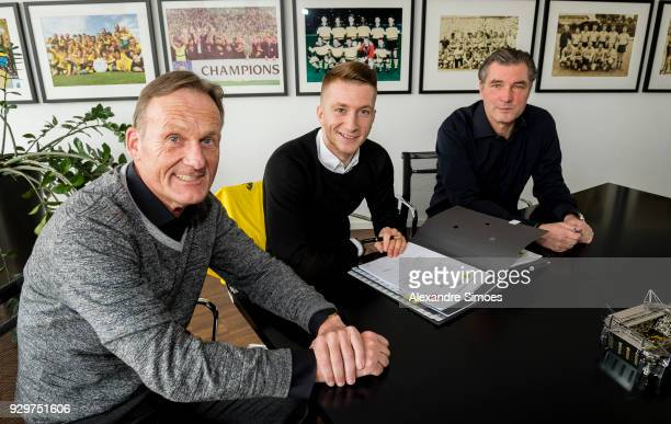 Marco Reus of Borussia Dortmund attends his contract extension signing for Borussia Dortmund with HansJoachim Watzke the CEO of Borussia Dortmund and...