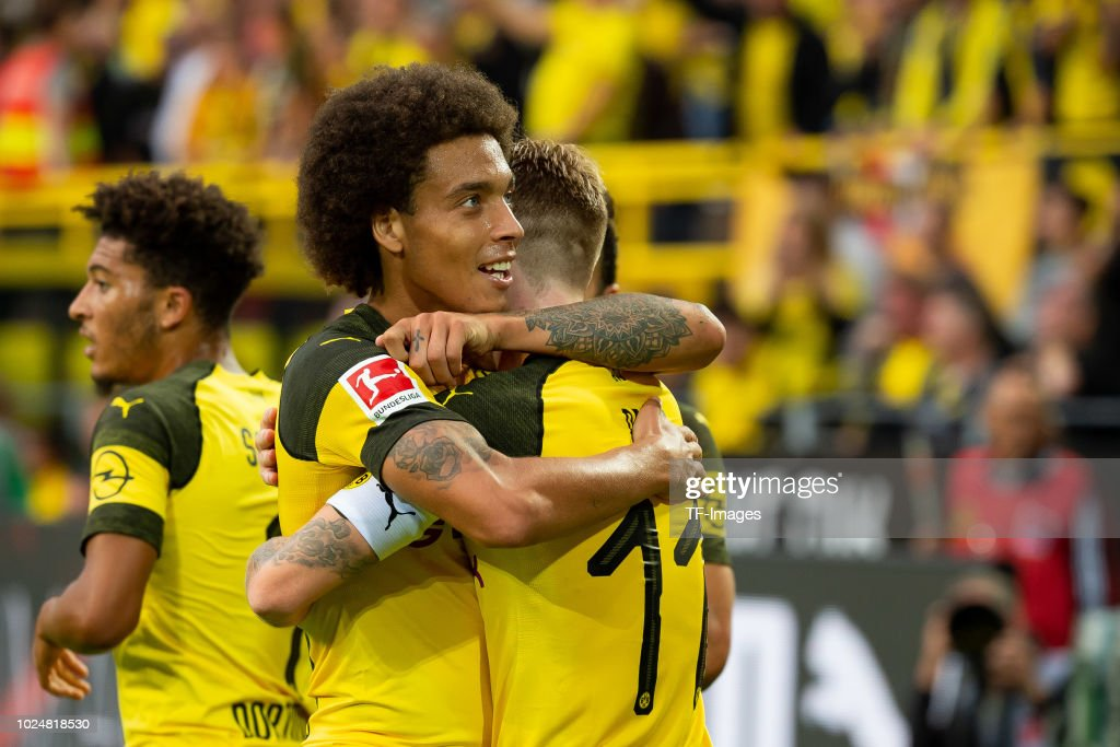 Marco Reus of Borussia Dortmund celebrates after scoring his team`s fourth goal with Axel Witsel of Borussia Dortmund during the Bundesliga match between Borussia Dortmund and RB Leipzig at Signal Iduna Park on August 26, 2018 in Dortmund, Germany.