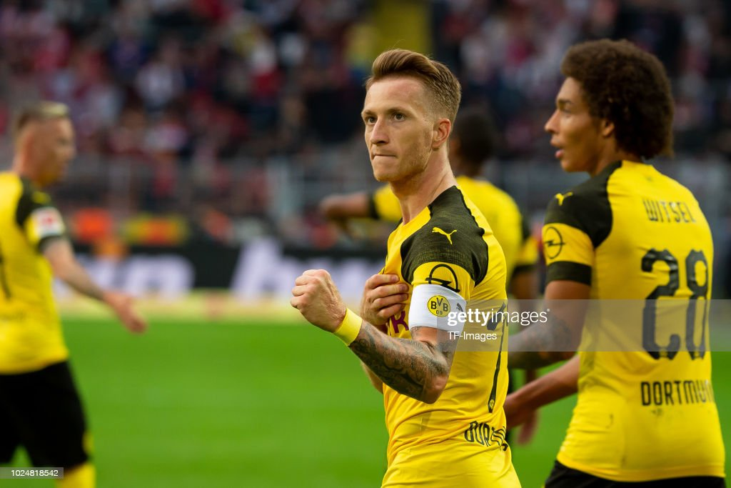 Marco Reus of Borussia Dortmund celebrates after scoring his team`s fourth goal during the Bundesliga match between Borussia Dortmund and RB Leipzig at Signal Iduna Park on August 26, 2018 in Dortmund, Germany.
