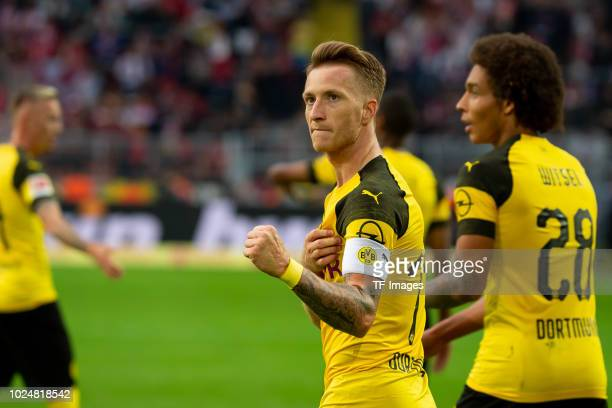 Marco Reus of Borussia Dortmund celebrates after scoring his team`s fourth goal during the Bundesliga match between Borussia Dortmund and RB Leipzig...