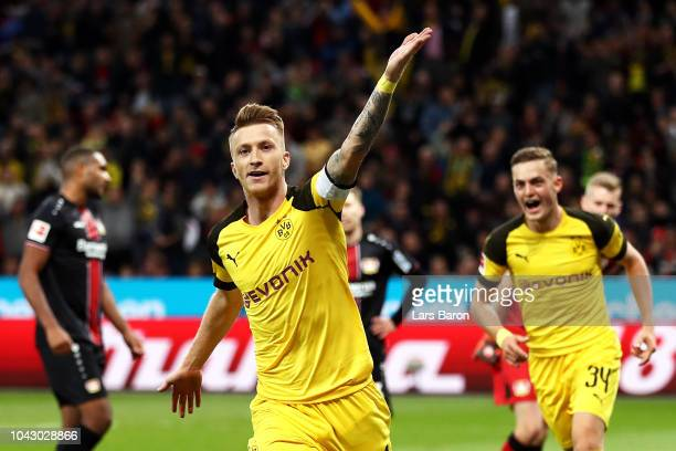 Marco Reus of Borussia Dortmund celebrates after scoring his team's second goal during the Bundesliga match between Bayer 04 Leverkusen and Borussia...