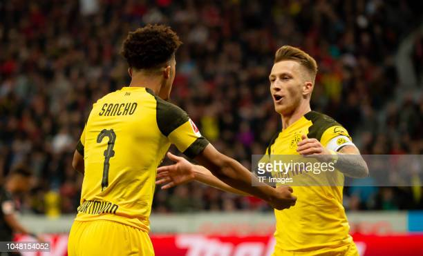 Marco Reus of Borussia Dortmund celebrates after scoring his team`s second goal with team mates Sancho of Borussia Dortmund during the Bundesliga...