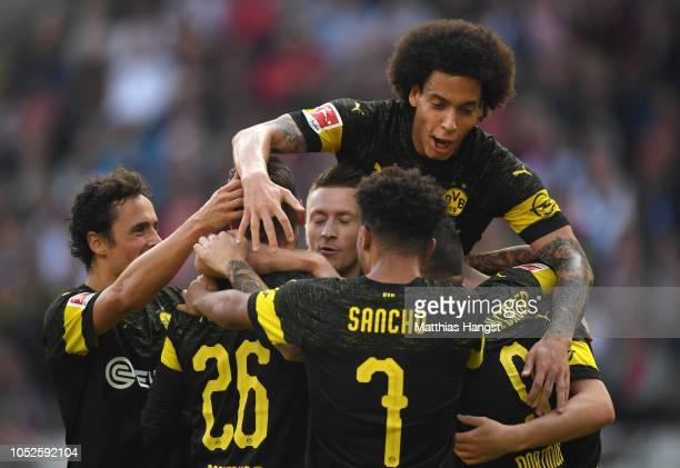 Marco Reus of Borussia Dortmund celebrates after scoring his team's third goal with his team mates during the Bundesliga match between VfB Stuttgart...