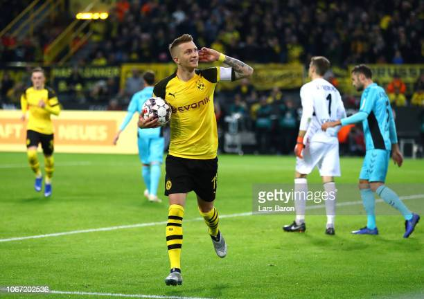 Marco Reus of Borussia Dortmund celebrates after scoring his team's first goal during the Bundesliga match between Borussia Dortmund and SportClub...
