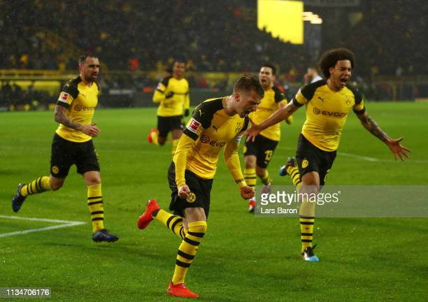 Marco Reus of Borussia Dortmund celebrates after scoring his team's first goal from the penalty spot during the Bundesliga match between Borussia...