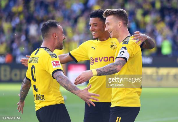 Marco Reus of Borussia Dortmund celebrates after scoring his team's second goal with Jadon Sancho and Paco Alcacer during the Bundesliga match...