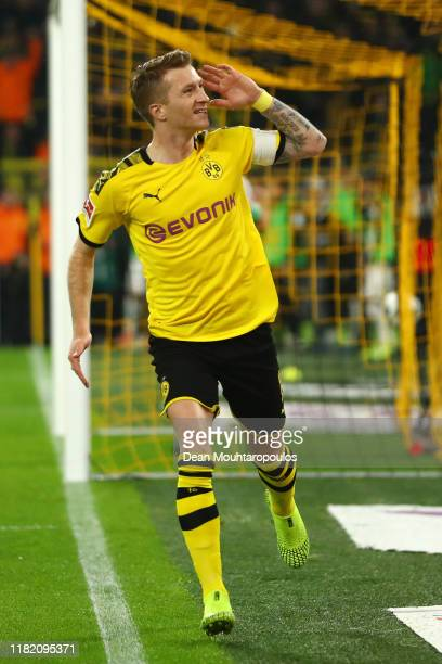 Marco Reus of Borussia Dortmund celebrates after scoring his team's first goal during the Bundesliga match between Borussia Dortmund and Borussia...