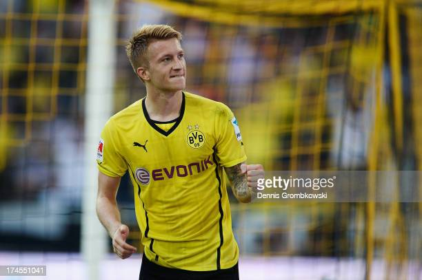 Marco Reus of Borussia Dortmund celebrates after scoring his team's first goal during the DFL Supercup match between Borussia Dortmund and FC Bayern...