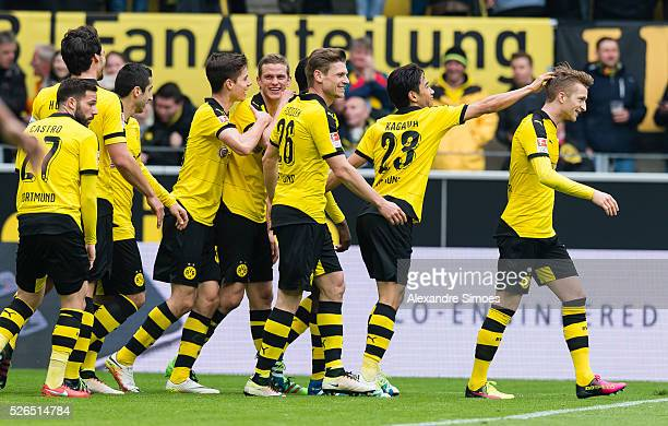 Marco Reus of Borussia Dortmund celebrates after scoring the goal to the 30 together with his team mates during the Bundesliga match between Borussia...