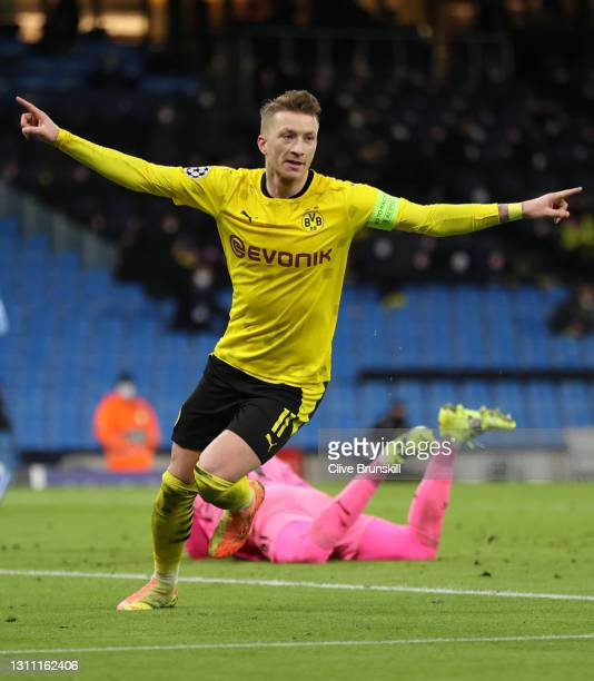 Marco Reus of Borussia Dortmund celebrates after scoring their team's first goal during the UEFA Champions League Quarter Final match between...