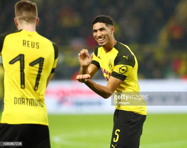 Marco Reus of Borussia Dortmund celebrates after scoring with his team mate Achraf Hakimi during the Bundesliga match between Borussia Dortmund and...