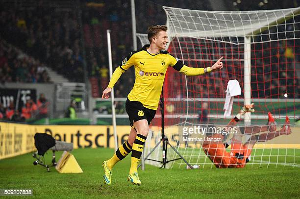 Marco Reus of Borussia Dortmund celebrates as he scores their first goal during the DFB Cup Quarter Final match between VfB Stuttgart and Borussia...