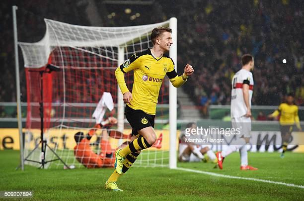 Marco Reus of Borussia Dortmund celebrates as he scores their first goal during the DFB Cup Quarter Final match between VfB Stuttgart and Borussia...
