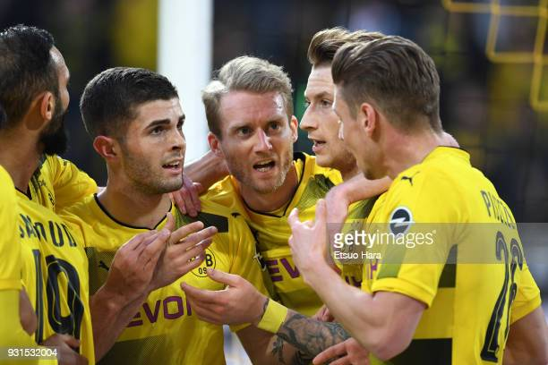 Marco Reus of Borussia Dortmund celebrates his side's first goal with his team mates during the Bundesliga match between Borussia Dortmund and...
