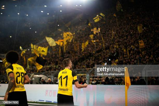 Marco Reus of Borussia Dortmund celebrates in front of fans with teammate Axel Witsel after scoring his team's first goal during the Bundesliga match...