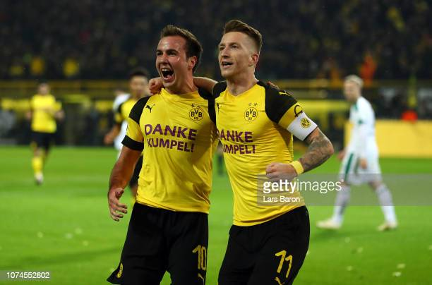 Marco Reus of Borussia Dortmund celebrates scoring his side's second goal with Mario Gotze of Borussia Dortmund during the Bundesliga match between...