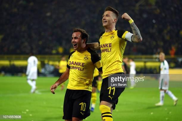 Marco Reus of Borussia Dortmund celebrates scoring his side's second goal with Mario Gotze of Borussia Dortmund during the Bundesliga match between...