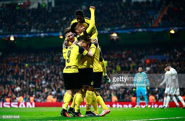 Marco Reus of Borussia Dortmund celebrates scoring his sides second goal with his Borussia Dortmund team mates during the UEFA Champions League Group...