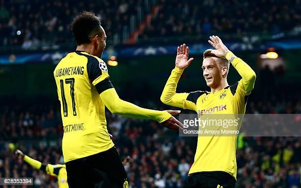 Marco Reus of Borussia Dortmund celebrates scoring his sides second goal with PierreEmerick Aubameyang of Borussia Dortmund during the UEFA Champions...