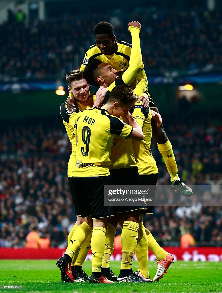 Marco Reus of Borussia Dortmund celebrates scoring his sides second goal with his Borussia Dortmund team mates during the UEFA Champions League Group F match between Real Madrid CF and Borussia Dortmund at the Bernabeu on December 7, 2016 in Madrid, Spain.