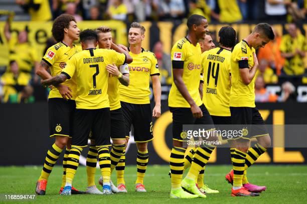Marco Reus of Borussia Dortmund celebrates scoring his sides third goal during the Bundesliga match between Borussia Dortmund and FC Augsburg at...