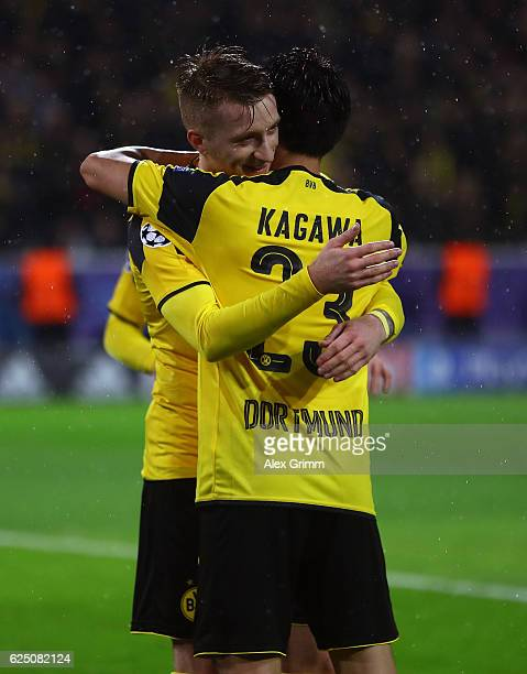 Marco Reus of Borussia Dortmund celebrates scoring his teams fifth goal with teammate Shinji Kagawa during the UEFA Champions League Group F match...